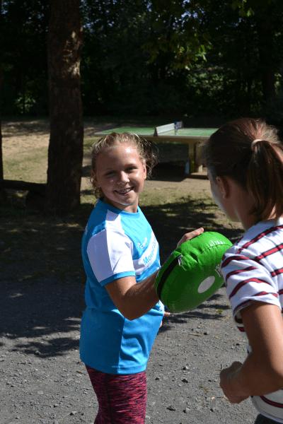 Arbeite im Team und finde neue Freunde im Kampfsport Camp